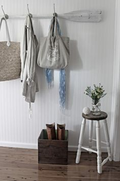 Love everything about this entryway - oar coat rack, Marseille tote, butter box, & jar vase