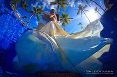 valdorama.com, Artistic Underwater Afterglow / Post wedding photo session, Majestic Elegance, Punta Cana, Dominican Republic, pool, dress, kissing, blue, palm trees, ripples