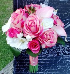 This listing is made to order and Includes 1 10-12in Diameter Bouquet $135 as shown in the photos. Flowers in Bouquet include Real Touch Coral Pink Roses, Real Touch Coral Pink Rose Buds, Real touch I