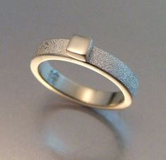 SILVER NUGGET RING Gritty matte texture on heavy silver band featuring a shiny square silver cube as the focal point. Simple yet elegant! Made to order, select your size. Ring Sizes available are: 5 inside diameter] inside diameter] 6 inside diameter]