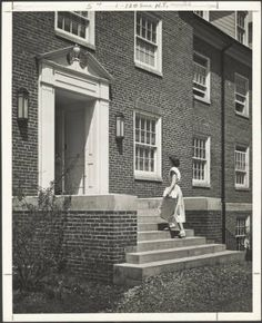 Hudson University Health Center front door, ca. 1950. Hudson is located between Voigt Hall and Glidden Hall. During the 1949 Christmas vacation the university medical equipment was transferred from the Health Center located in the basement of Tupper Hall (New) to the new health center. Hudson was open when the students returned to campus. At that time the forty-bed facility was considered one of the most outstanding student health centers in the nation.  :: Ohio University Archives