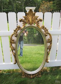 She leans an old mirror on her fence & wait til you see what she does in her kitchen!