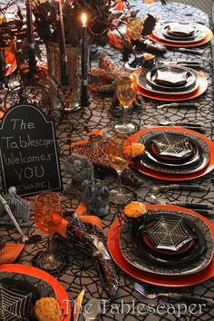 Wonderfully spooky dinner set up with grave stones, spider webs, and bats! Oh my!