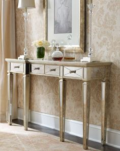 """favorite console  """"Amelie"""" Mirrored Console - Neiman Marcus $999 off 1499.  Narrow hall console gleams with mirrored veneers and an antique-silver finish with golden accents. Made of select hardwood solids with beveled-edge, antiqued mirrored veneers. Three drawers. 58""""L x 13""""W x 35""""T."""