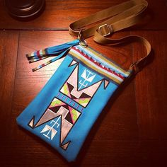 Hand made, 8 band tradecloth cross body bag with design and thread work.  Flying Horse Designs