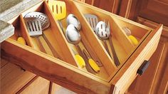 Maximize Kitchen Drawer Space by Storing Utensils Diagonally  -  -  To connect with us, and our community of people from Australia and around the world, learning how to live large in small places, visit us at www.Facebook.com/TinyHousesAustralia