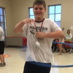 Chase had a #luau at school today with his  class. Great opportunity to show off his mad #hulahooping #skills. I really dig his classmates #spinning too #ichoopers #autismstars #spectrumflow @glitterhoopz #specialneeds hula #hooping is for EVERYONE! by glitterhoopz