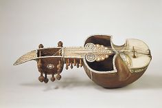 A Sarinda... Late 19th century, India. Made of teak, parchment, ivory, horsehair