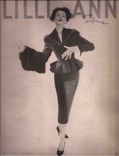 1957 Lilli Ann suit with flared peplum jacket that has a fur trimmed collar, long narrow skirt to below knee.