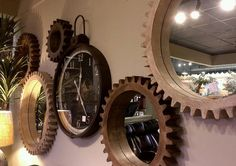 Check out these awesome clocks and mirrors made out of wooden gears, great for around the home decor.