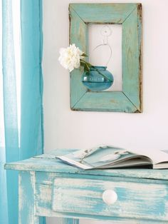 Interesting 3D art with re-purposed picture frame, blue bottle and flower #walldecor