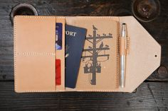The perfect travel companion! Entirely hand stitched with 4-5oz outer and 3-4oz interior vegetable tanned leathers, and the edges are burnished smooth by hand with water and beeswax.   This travel wallet will develop a rich patina over time and will last a lifetime.  Comfortably fits a notepad, a p