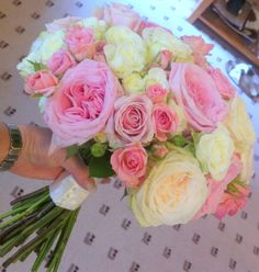 Hand tied bouquet of O'Hara roses by Bows & Blooms