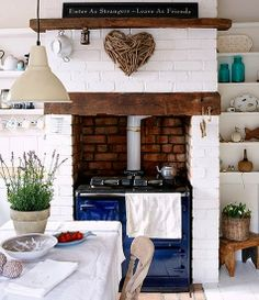 Driftwood heart hangs in the kitchen of a Beach Bungalow.