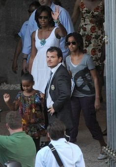 Pin for Later: 33 Times the Obamas Bonded During Their Family Vacations  During a July 2009 trip to Italy, the first lady waved to a crowd after touring the Colosseum with Sasha and Malia.