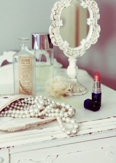 vintage glamour--I had a mirror like the one in the pic. It was metal and the mirror could be tilted.