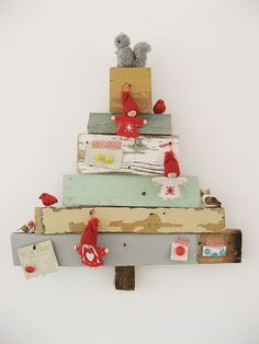 my kind of Christmas tree.  reclaimed lumber with squirrel and knitted figures and red bird