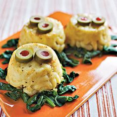 Mac and Cheese Swamp CreaturesA great Halloween side-dishIngredients Macaroni and cheese Sautéed spinach Green Olive with Pimento slices Instructions Mix up a batch of macaroni and cheese, then spo...