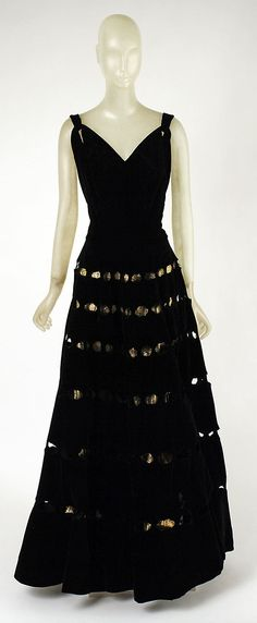 Dress, Evening  Madeleine Vionnet (French, Chilleurs-aux-Bois 1876–1975 Paris)  Date: fall/winter 1939–40 Culture: French Medium: silk, metal thread Dimensions: [no dimensions available] Credit Line: Gift of Mrs. Harrison Williams, Lady Mendl, and Mrs. Ector Munn, 1946