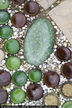 Decorative use of sunken, upturned bottles - I have lots of treasures to use! @Sharon Macdonald Macdonald Moulenbelt