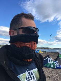 100% Merino Wool in burnt orange, charcoal grey & black stripes.  a beautiful hand knit snood scarf. The perfect accessory to wear on a bike ride, under your motorcycle helmet, or even for your workout.