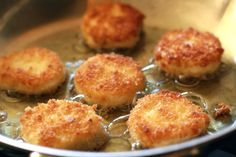 Fried Goat Cheese Medallions for a Salad.  Use dental floss to slice goat cheese, dip in flour, egg, panko, then I put in the freezer on a plate for a well.  Pan fry when ready and serve hot.