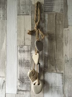 A five hag stone hanging decoration/Coastal Decor available to purchase from Mermaid Gifts