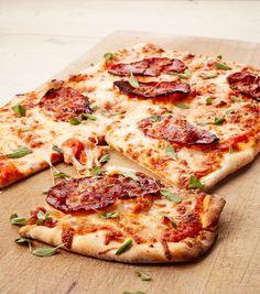 Crispy pizza with chorizo and herbs