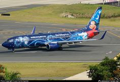 WestJet (CA) Boeing 737-8CT(WL) C-GWSZ aircraft, painted in ''Walt Disney World - Mickey Mouse'' special colors, with the sticker ''Walt Disney World'' on the fuselage, rolling at Puerto Rico, Carolina, San Juan Luis Muñoz Marín Int'l Airport. 19/04/2015.