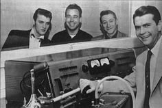 Elvis Presley, bass player Bill Black, guitarist Scotty Moore and Sun Records and Memphis Recording studio head Sam Phillips take a break from a recording session in Memphis. Presley cut his first records in the studio owned by Phillips. Rock And Roll, Rock N, Genre Musical, Scotty Moore, Sam Phillips, Photos Rares, Sun Records, Jerry Lee Lewis, Young Elvis