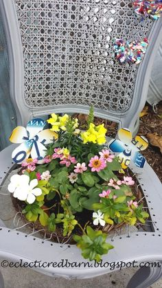 Decorate your garden with cut up license plates!