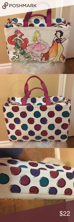 EUC Disney handbag. EUC Disney princess handbag bought from Disneyland. I used it as a purse but also to carry makeup and toiletries when going out of town. Measures 13 1/2 across by 10 1/2 deep. Sorry missing the shoulder strap but still trying to look for it Disney Bags Totes