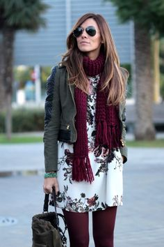 Dress down a floral dress with a cropped jacket, knitted scarf and tonal tights.