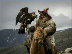 USA Today Photos of the Year: Altaic Kazakh Golden Eagle Hunter. Western Mongolia.