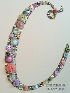 Button Art made with Swarovski Rhinestones and buttons!