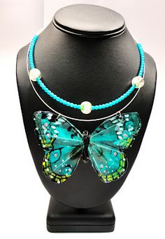 A feather butterfly plus resin = necklace!