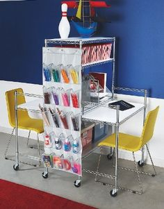 Howards Storage World | Kids easy-build Double Sided Desk and Shelving Solution  I like the shoe organiser to store stationary