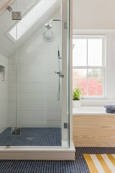 remember this look... same tile in and out of the shower provides a continuous look throughout the room. This Old House project, Cambridge, MA. K. Marshall Design.