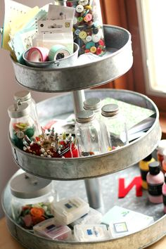 Use cake tins to make a cute stand to hold your small craft items. Maybe even paint them?? A patchwork design around the sides would look great