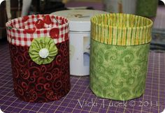 Cover tin cans with fabric & glue gun for decorative storage options.