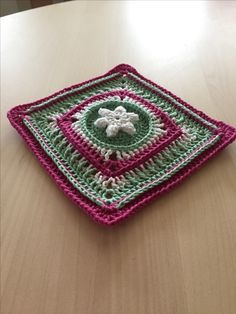 You can find this pattern l, the Cloudberry square, on Ravelry http://www.ravelry.com/patterns/library/cloudberry-flower-square