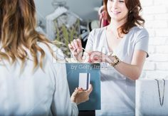 Customer paying in boutique Royalty Free Stock Photo