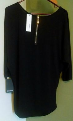 Never tried a Dolman top before, but they look very flattering.  Again, love the small details.