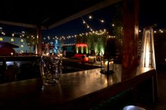 Where to Eat and Drink with a View of Downtown Houston - Eater Houston Rooftop Lounge, Rooftop Bar, Proof Bar, Houston Bars, Wood Patio, Seafood Restaurant, Fine Dining, Backdrops, Neon Signs