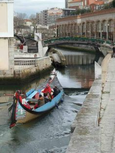 Aveiro, sometimes known as the 'Venice of Portugal' due to the arched bridges over the network of canals and the moliceiro boats.