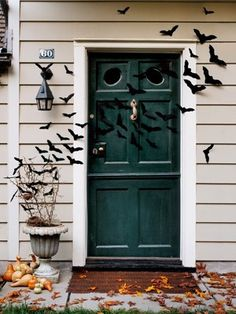 Bat-Filled Front Door    These felt bats are easy to make and ensure your house looks extra spooky. All you need to do is trace a bat shape onto a piece of felt and cut it out. Repeat until you have a swarm of them.      Read more: Halloween Craft Ideas for Kids - Halloween Craft Projects - Country Living halloween
