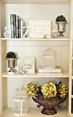 a-z bookends, white frame, candle snuffer, urns, boxwood balls, cloche, & bookend, hydrangeas