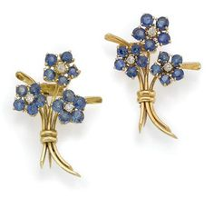Pair of Gold, Sapphire and Diamond Scatter Pins, Van Cleef & Arpels   The two pins designed as 6 florets set with 30 round sapphires, centering 6 small round diamonds, tied together by polished gold wire, signed VCA for Van Cleef & Arpels, NY # 953 and # 1135, circa 1950, approximately 6.5 dwt.