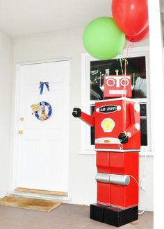 This robot greeter was just the first of many delights in store for guests at JD's party. Adriana shares: My son loves robots and is fascinated by the Good Year Blimp (which is stationed locally and he thinks is a rocket ship, lol), so I thought a Robots and Rockets party would be perfect!