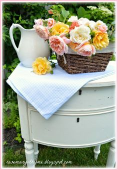Basketful of roses, ironstone pitcher, vintage table, white French bistro chair - heavenly bliss!  Rosemary and Thyme blog